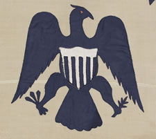 RARE REVENUE CUTTER SERVICE FLAG WITH A BLUE EAGLE AMID AN ARCH OF 13 BLUE STARS, ON A WHITE FIELD, AND AN UNUSUAL COUNT OF 17 VERTICAL RED AND WHITE STRIPES, CA 1880-1895