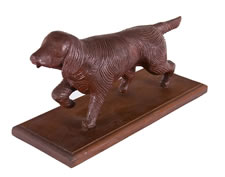 HAND-CARVED, WOODEN SETTER OR SPANIEL DOG WITH RED PAINTED SURFACE, CA 1920-40
