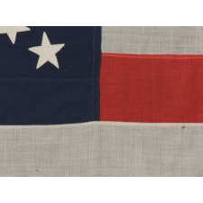 "44 STARS CONFIGURED INTO THE LETTERS ""U.S."", PATENTED IN 1890 BY W.R. WASHBURN, ONE OF ONLY FOUR KNOWN SURVIVING EXAMPLES AND ONE OF THE BOLDEST DESIGNS KNOWN TO EXIST IN EARLY FLAGS"