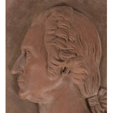 SUBSTANTIAL AND BEAUTIFUL TERRACOTTA BUST OF GEORGE WASHINGTON IN A WALL-HANGING PLAQUE, MADE IN NEW YORK, SIGNED & DATED 1887