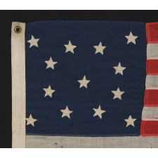 13 CURIOUSLY SMALL STARS IN A MEDALLION CONFIGURATION, ON A SMALL-SCALE FLAG OF THE 1890-1900 ERA, WITH WONDERFUL PRESENTATION