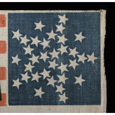 "33 STARS IN AN INTERESTING VARIATION OF THE ""GREAT STAR"" CONFIGURATION, MADE FOR THE 1860 CAMPAIGN OF ABRAHAM LINCOLN & HANNIBAL HAMLIN, WITH WHIMSICAL SERPENTINE TEXT"