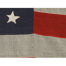 38 HAND-SEWN STARS STITCHED WITH BROWN THREAD TO A STEEL BLUE CANTON, AN ANTIQUE MERICAN FLAG WITH EXCEPTIONAL CONDITION, COLORADO STATEHOOD, 1876-1889