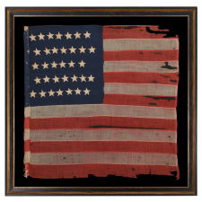 WOOL, CIVIL WAR, UNION INFANTRY BATTLE FLAG WITH 34 STARS AND EXCEPTIONAL PRESENTATION FROM HAVING BEEN EXTENSIVELY CARRIED, ACCOMPANIED BY ITS ORIGINAL STAFF, 1861-1863
