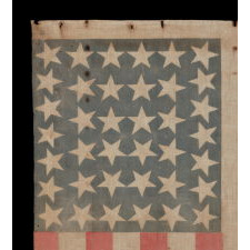38 LARGE STARS POINTING IN VARIOUS DIRECTIONS ON AN ANTIQUE AMERICAN PARADE FLAG WITH PERSIMMON STRIPES, AN ABSOLUTELY BEAUTIFUL EXAMPLE IN A VARIATION THAT I HAVE NOT BEFORE SEEN, COLORADO STATEHOOD, 1876-1889
