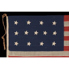 ENTIRELY HAND-SEWN, 13 STAR, U.S. NAVY SMALL BOAT ENSIGN WITH A 4-5-4 CONFIGURATION, MADE SOMETIME BETWEEN 1850 AND THE OPENING YEARS OF THE CIVIL WAR (1861-63)