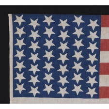 42 UPSIDEDOWN STARS IN A WAVE CONFIGURATION ON A BRILLIANT BLUE CANTON, 1889-1890, WASHINGTON STATEHOOD, AN UNOFFICIAL STAR COUNT