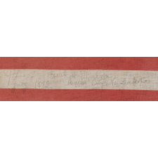 44 STARS IN A NOTCHED PATTERN ON A LARGE AMERICAN PARADE FLAG WITH A PENCILED INSCRIPTION FROM A CELEBRATION OF JULY 4TH IN NORTH DAKOTA, 1890-1896, REFLECTS WYOMING STATEHOOD, EX-RICHARD PIERCE COLLECTION