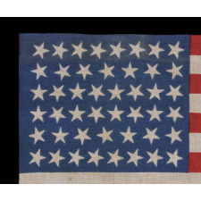 46 STARS ON A BRILLIANT ROYAL BLUE CANTON, ON AN ANTIQUE AMERICAN FLAG OF THE 1907-1912 PERIOD, OKLAHOMA STATEHOOD, SCATTERED STAR POSITIONING