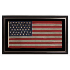 45 STARS ON AN ANTIQUE AMERICAN FLAG WITH ELONGATED PROPORTIONS AND IN A SMALL SCALE FLAG OF THE PERIOD AMONG THOSE WITH PIECED-AND-SEWN CONSTRUCTION, 1896-1908, SPANISH-AMERICAN WAR ERA, UTAH STATEHOOD