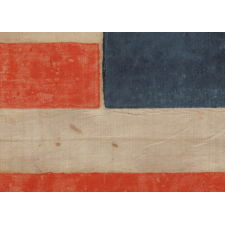 """CAMPAIGN PARADE FLAG MADE FOR THE 1860 PRESIDENTIAL RUN OF NORTHERN DEMOCRAT STEPHEN DOUGLAS, WITH 31 STARS IN AN INTERESTING VARIATION OF THE """"GREAT STAR"""" CONFIGURATION AND BOLD LETTERING IN A SERPENTINE FORMAT, THE ONLY EXAMPLE PRESENTLY KNOWN IN THIS LARGE SCALE AMONG ITS COUNTERPARTS"""