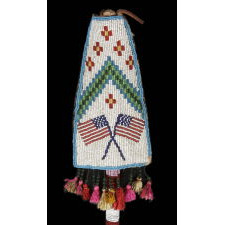 ASSINIBOINE (STONE SIOUX) BEADED DRUM STICK, A GREAT FORM WITH AMERICAN FLAG IMAGERY, CA 1890, GROS VENTRE REGION