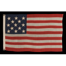 13 STARS ARRANGED IN A 3-2-3-2-3 PATTERN ON A SMALL-SCALE ANTIQUE AMERICAN FLAG MADE IN THE PERIOD BETWEEN THE LAST DECADE OF THE 19TH CENTURY AND THE FIRST QUARTER OF THE 20TH