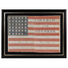 35 STARS IN A NOTCHED PATTERN ON A FLAG MADE FOR THE 1864 PRESIDENTIAL CAMPAIGN OF ABRAHAM LINCOLN & ANDREW JOHNSON; A MONUMENTAL EXAMPLE AND THE SECOND TO THE LARGEST KNOWN AMONG ALL CAMPAIGN PARADE FLAGS OF THE 19TH CENTURY, ACROSS ALL ELECTIONS