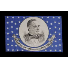 SILK PARADE FLAG WITH 46 STARS ON A STRIKING, ROYAL BLUE GROUND, MADE FOR THE 1900 PRESIDENTIAL CAMPAIGN OF WILLIAM McKINLEY, FEATURING A LARGE PORTRAIT AND A GREAT SLOGAN
