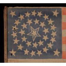 35 STARS IN A MEDALLION CONFIGURATION WITH A LARGE, HALOED CENTER STAR, ON ITS ORIGINAL WOODEN STAFF, CIVIL WAR PERIOD, WEST VIRGINIA STATEHOOD, 1863-65