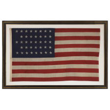"""38 STARS IN A """"NOTCHED"""" PATTERN ON A CLAMP-DYED AMERICAN FLAG OF THE 1876-1889 PERIOD, REFLECTS COLORADO STATEHOOD, MADE BY THE U.S. BUNTING COMPANY IN LOWELL, MASSACHUSETTS"""
