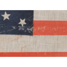 38 STARS IN A BEAUTIFUL MEDALLION CONFIGURATION WITH 2 OUTLIERS, ON A LARGE SCALE ANTIQUE AMERICAN PARADE FLAG OF THE 1876-1889 ERA, COLORADO STATEHOOD