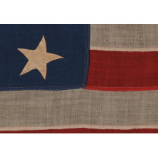 13 HAND-SEWN STARS IN A 3-2-3-2-3 PATTERN ON AN ANTIQUE AMERICAN FLAG OF THE 1876 CENTENNIAL ERA, POSSIBLY A U.S. NAVY SMALL BOAT ENSIGN