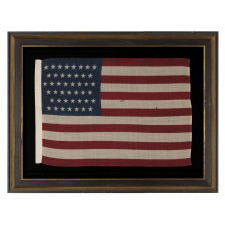 44 STARS IN ZIGZAGGING ROWS ON A PRESS-DYED WOOL AMERICAN FLAG, PROBABLY MADE BY THE HORSTMANN COMPANY IN PHILADELPHIA, POSSIBLY FOR USE AS A MILITARY CAMP COLORS, 1890-1896, REFLECTS WYOMING STATEHOOD