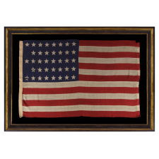 """38 STARS IN A """"NOTCHED"""" PATTERN ON A 5 ft. CLAMP-DYED AMERICAN FLAG OF THE 1876-1889 PERIOD, REFLECTS COLORADO STATEHOOD, MADE BY THE U.S. BUNTING COMPANY IN LOWELL, MASSACHUSETTS"""
