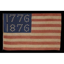 """ANTIQUE AMERICAN FLAG WITH 10-POINTED STARS THAT SPELL """"1776 – 1876"""", MADE FOR THE 100-YEAR ANNIVERSARY OF AMERICAN INDEPENDENCE, ONE OF THE MOST GRAPHIC OF ALL EARLY EXAMPLES"""