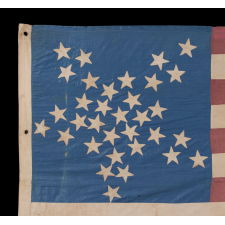 """33 STARS IN A """"GREAT STAR"""" OR """"GREAT LUMINARY"""" PATTERN ON A HOMEMADE FLAG WITH A BEAUTIFUL, GLAZED COTTON CANTON, 1859-61, PRE-CIVIL WAR THROUGH WAR PERIOD, OREGON STATEHOOD"""