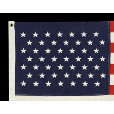 49 EMBROIDERED STARS ON A SMALL SCALE PIECED-AND-SEWN AMERICAN FLAG REFLECTING THE ADDITION OF ALASKA IN 1959, OFFICIAL FOR JUST ONE YEAR, MADE BY ANNIN IN NEW YORK CITY