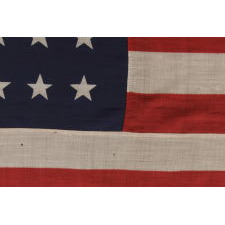 """38 STARS IN A """"NOTCHED"""" PATTERN ON A 7 ft. CLAMP-DYED AMERICAN FLAG OF THE 1876-1889 PERIOD, REFLECTS COLORADO STATEHOOD, MADE BY THE U.S. BUNTING COMPANY IN LOWELL, MASSACHUSETTS"""