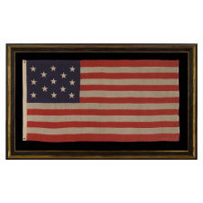 13 STARS ARRANGED IN A 3-2-3-2-3 PATTERN ON A SMALL-SCALE FLAG OF THE 1890'S-1910 ERA, WITH AN ATTRACTIVE, ELONGATED PROFILE AND AN UNUSUAL 5-FOOT LENGTH