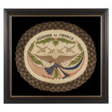 FRANCO-AMERICAN TEXTILE WITH THE IMAGE OF AN EAGLE SUPPORTING KNOTTED & DRAPED AMERICAN AND FRENCH FLAGS BENEATH FOUR WAR PLANES; EMBROIDERED SILK FLOSS AND METALLIC BULLION THREAD ON A SILK GROUND, WITH ELABORATE BULLION FRINGE, MADE TO CELEBRATE THE END OF WWI (U.S. INVOLVEMENT 1917-18)