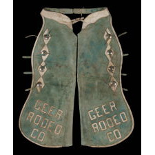 LEATHER CHAPS WIH NICKEL-PLATED CONCHOS, BLUE-GREEN AND WHITE WITH WONDERFUL WEAR AND PATINA, MADE FOR THE GEER RODEO COMPANY OF MANTANA, ca 1960 - 1970's