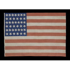 39 CANTED STARS ON AN ANTIQUE AMERICAN FLAG DATING TO THE 1876 CENTENNIAL, NEVER AN OFFICIAL STAR COUNT, REFLECTS THE ANTICIPATED ARRIVAL OF THE DAKOTA TERRITORY