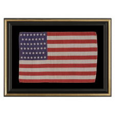 46 STARS IN CANTED ROWS ON AN ANTIQUE AMERICAN PARADE FLAG MADE OF SILK, 1907-1912, OKLAHOMA STATEHOOD