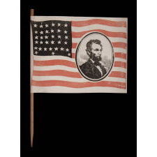 """EXTREMELY RARE ABRAHAM LINCOLN MOURNING FLAG, WITH HIS PORTRAIT IN THE STRIPED FIELD, ON ITS ORIGINAL STAFF; PRINTED ON PAPER, SIGNED """"LYBRAND,"""" 1865"""