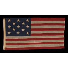 13 STARS ARRANGED IN A 3-2-3-2-3 PATTERN ON A SMALL-SCALE FLAG OF THE 1890's-1910 ERA, WITH AN ATTRACTIVE, ELONGATED PROFILE