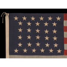 "32 STARS, COMMEMORATING MINNESOTA STATEHOOD, CA 1892 – 1926, A VERY RARE FLAG, IN A SMALL SIZE, WITH AN HOURGLASS OR ""GLOBAL ROWS"" CONFIGURATION"