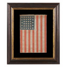 "34 STARS IN A LINEAL ARRANGEMENT THAT RESULTS IN A CONFIGURATION THAT I HAVE TERMED ""GLOBAL ROWS,"" ON AN ANTIQUE AMERICAN FLAG MADE DURING THE OPENING TWO YEARS OF THE CIVIL WAR, 1861-63, KANSAS STATEHOOD"