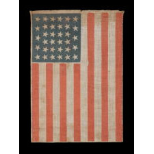 """34 STARS IN A LINEAL ARRANGEMENT THAT RESULTS IN A CONFIGURATION THAT I HAVE TERMED """"GLOBAL ROWS,"""" ON AN ANTIQUE AMERICAN FLAG MADE DURING THE OPENING TWO YEARS OF THE CIVIL WAR, 1861-63, KANSAS STATEHOOD"""