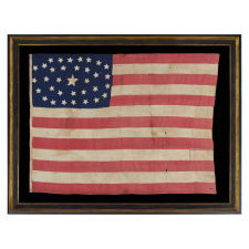 34 STARS IN AN OUTSTANDING OVAL MEDALLION CONFIGURATION ON A NARROW CANTON THAT RESTS ON THE 6TH STRIPE, A HOMEMADE, ANTIQUE AMERICAN FLAG OF THE CIVIL WAR PERIOD, ENTIRELY HAND-SEWN, 1861-63, KANSAS STATEHOOD