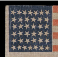 38 STAR ANTIQUE AMERICAN FLAG WITH SCATTERED STAR POSITIONING MADE DURING THE PERIOD WHEN COLORADO WAS THE MOST RECENT STATE TO JOIN THE UNION, 1876-1889
