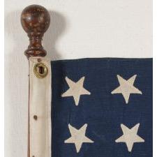 48 STAR JACK ON THE ORIGINAL TURNED HARDWOOD STAFF OF A CHRIS CRAFT, 1930-1955