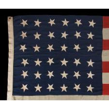 "36 SINGLE-APPLIQUÉD STARS ON AN ANTIQUE AMERICAN FLAG OF THE CIVIL WAR ERA, SIGNED ""J.A. STEWART,"" 1864-1867, NEVADA STATEHOOD"